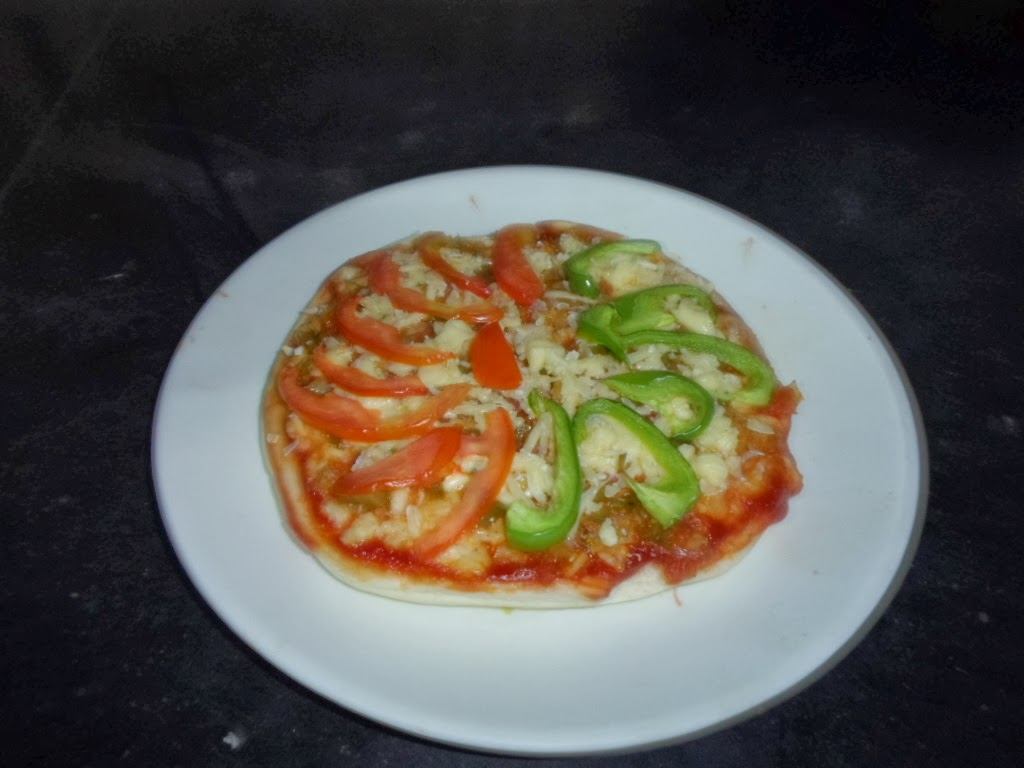 A make at home pizza recipe using cheese, capsicum and cabbage